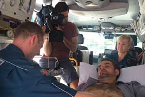 Lachlan Parker from QAS uses ultrasound in the ambulance to detect internal injuries in patient Tony Kynn. Mr Kynn sustained internal bleeding and a ruptured spleen after a kick from a horse.