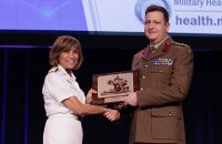 Professor Michael Reade accepting the award at the US Military Health System Research Symposium in Orlando, Florida.