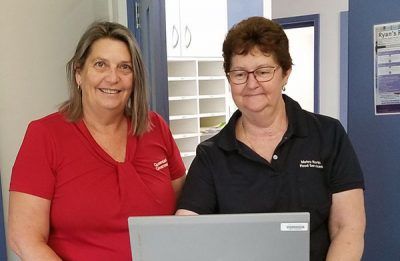 Caboolture Hospital Dietetic Assistant Sharmaine McBain and Kilcoy Hospital Cook Kathy Ellem collecting lunch orders using the computer workstation on wheels.