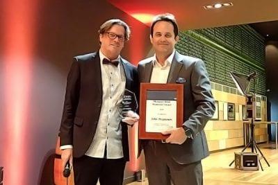 Image of Metro North Public Health Unit Director John Piispanen receiving his award